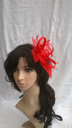 Items similar to Stunning Sinamay and Feather Fascinator with double swirls    loops..on a comb on Etsy c3397edd7122