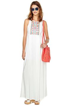 You and your tribe have a crazy summer ahead, and we have the perfect maxi dress. Features prince...
