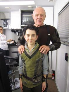 Odin with little Loki SQUEE! Older Loki is hot, but little Loki is simply ADORABLE!! He's cuter than a puppy!!