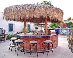 Backyard palapa style island barbeque using Mexican tiles by kristiblackdesigns.com by kristiblackdesigns.com