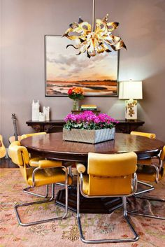 Bright and happy dining room.  metal cantilever chairs, brass flower chandelier