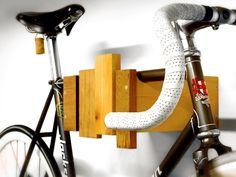 wall mounted bike rack - reclaimed wood - clear oil finish. $95.00, via Etsy.    In my dreams. But a really cool bike rack!