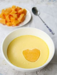 Steamed Eggs with Papaya and Milk has eggs' fresh and tender, milks' milk aroma and papaya's faint sweetness, is a nutritious and delicious love breakfast for your family.