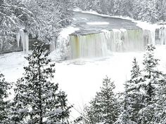 Winter at Tahquamenon Falls. Pure Michigan. we were there last winter and it was truly breathtaking to see!