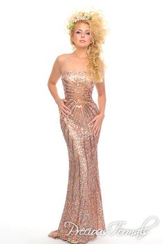 Precious Formals Style P8799 hand sewn square and round sequins radiate from the center of this stunning strapless long gown.