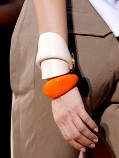 Molded cuffs. Modern geometric shapes. Nude color matched with bright bold orange.