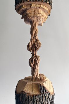 maskull lasserre chisels giant tree trunk down to a precariously frayed rope