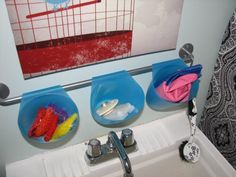 Ikea Bygel containers & rail to corral laundry sink sponges, brushes, plug & rubber gloves.