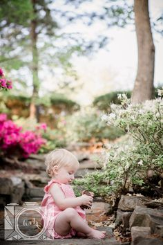 Little girl sitting and playing with sticks on the rocks at her 1 year old session at Baxter Gardens by Knoxville Wedding Photographer, Amanda May Photos.