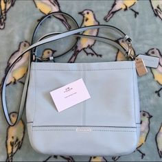"""New Coach blue park leather mini duffle crossbody Beautiful new robins egg blue. Buttery soft leather. Zipper closure at top 9"""". 2 inside slide pockets cross body strap is removable. Never carried but does not have the hang tags. Metal tag still has the plastic. Care card inside. I am never insulted by offers Coach Bags Crossbody Bags"""