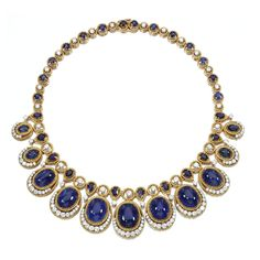 SAPPHIRE AND DIAMOND NECKLACE, VAN CLEEF & ARPELS Designed as an alternating line of brilliant-cut diamonds and circular-cut and pear-shaped sapphires, suspending eleven graduated drops set with cabochon sapphires, highlighted with brilliant-cut diamonds within gold corded wire mounts, mounted in platinum and gold