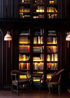 Love the lighting and these black bookcases. So rich and inviting. [The Virtual Builder]