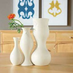 Vases. In the background is Wall Art also designed by Eva Zeisel.