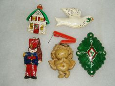 Heres a nice group of five vintage Christmas tree ornaments made out of decorated salt dough. Includes a white dove, green medallion, angel,