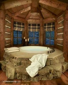 Beautiful master bath inside or outside or a hot tub outside in a Tudor style home with a turret.