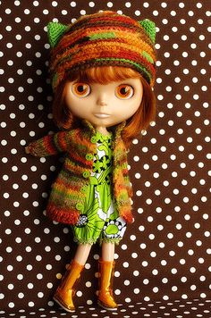 Doll with knitted coat and hat