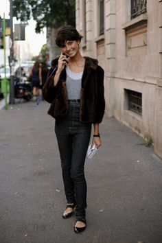 Excellent use of a fur shrug, jeans, and flats.