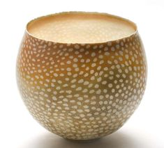 Okay, my most recently found favorite ceramic artist ... Jane Reumert. I love love love the delicate look of her vessels, and the patterns, the colors!