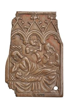 Writing tablet Bone writing tablet, decorated with a Nativity scene. The Virgin Mary is shown lying in bed with a swaddled baby Jesus on her right side. Above her stands the figure of Joseph and an angel holding a scroll. The scene is topped by an architectural canopy. There are traces of red pigment in the background of the scene and in the spandrels of the canopy. The reverse is recessed to contain the wax for writing in.  Production Date: Late Medieval; 15th century