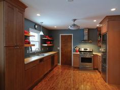 Kitchen maple cabinets blue gray walls