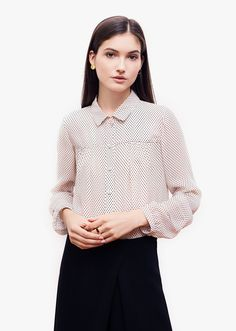 Lauren ivory shirt. Classic shirt tailoring is balanced by feminine details. Gentle folds at front and back, delicate pleats on the sleeves, playful transparency and fun polka-dots. The loose silhouette brings fluidity and softness, while ensuring a comfortable fit. Fall Capsule, Polka Dots, Bell Sleeve Top, Bring It On, Delicate, Feminine, Ivory, Silhouette, Classic