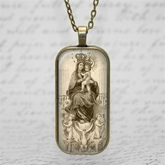 Blessed Mother Virgin Mary Child Jesus sepia tone religious art glass tile pendant necklace  The laser printed image has been adhered to a glass tile and a 1 x 2 domino sized pendant tray. There is a 24 vintage bronze lobster clasp chain  The coloration may fluctuate and be a bit more tan than what is seen on this screen image.  This is a made to order. Please allow 3 days.  This would be a great and thoughtful handmade and affordable gift.  Please do not wear the pendant in the shower as it…