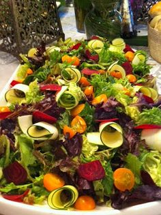 Beautiful salad with fresh beets, zucchini ribbons and heirloom tomatoes