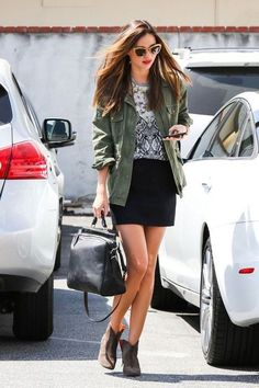 Shop this look for $119:  http://lookastic.com/women/looks/anorak-and-crew-neck-t-shirt-and-mini-skirt-and-shopper-handbag-and-ankle-boots/1178  — Green Anorak  — Grey Print Crew-neck T-shirt  — Black Mini Skirt  — Black Leather Tote Bag  — Brown Leather Ankle Boots
