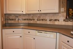 Kitchen Back Splash - Our kitchen had a plain white tile back splash. We had to remove the old tile, which pulled parts of the drywall with it. Once all the til…