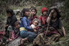 Nepalese earthquake survivors in the remote Kerauja village in Gorkha district watch as relief supplies are delivered by a World Food Programme helicopterPhillipe Lopez/AFP