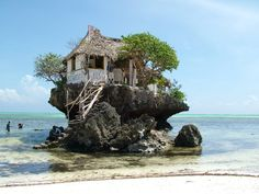 This restaurant in Zanzibar can be reached both by foot and by boat, depending on the tide. So cool!