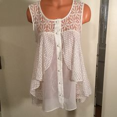 Beautiful loose and lacy top Very pretty and feminine top, layers of different lace patterns, buttons in front,ties in back. ❤️❤️ a'reve Tops Blouses