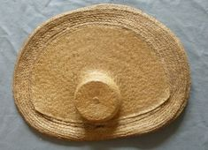 Straw hat, The Netherlands, 18th century. The huge brim plaited with a coarse straw, a finer plaited straw crown and inner brim, of oval shape with flattened back brim, the underside with radiating spine of coarser plaited straw.