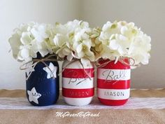 """This is a beautiful set of three American Flag Mason Jars. The blue jar is painted in an """"Admiral Blue"""" acrylic paint with large white starts. The"""