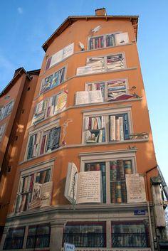 This mural is painted above La Bibliothèque De La Cité (Library of the City) in Lyon, France. Definitely a place to visit.