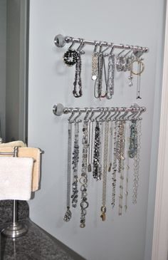 Towel racks with shower rings to hold jewerly! Saw it on here and did it. Love it!