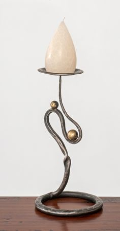 A taste of southern talent from Charleston Forge and friends. Hand forged and hammered candle stands/sculptures by Tom Wooten http://www.charlestonforge.com/cf-handforged/ak-106-108-mozarts-movements-candle-stand