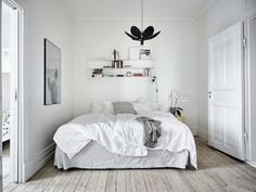 A calm swedish home in grey and white