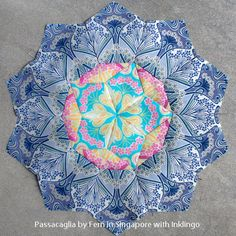 Passacaglia rosette from Millefiori Quilts, sewn with Inklingo by Fern in Singapore. http://lindafranz.com/shop/millefiori-quilt-templates/40