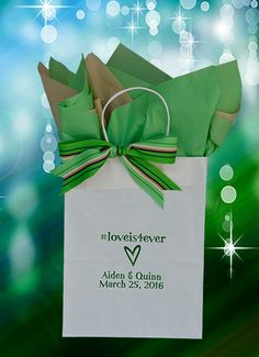 #weddingwelcomebag -Ooh La La. Aidan and Quinn plan their wedding at the Governors Club in Chapel Hill, NC. This is such a happy wedding guest gift bag. The ribbon of parrot green, mint green, khaki and brown is paired with apple green and khaki tissue papers. See more bags, ribbon and tissue paper at www.favorsyoukeep.com or call 512.323.0600. Family owned since 1987!