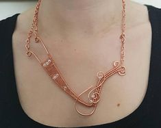 Bright copper handmade wire woven necklace with seed beads.