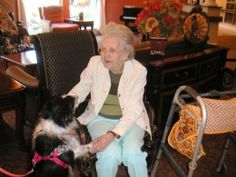 Visiting canine Roxy brings a smile to the resident's faces. Gift giving ideas for nursing home seniors.