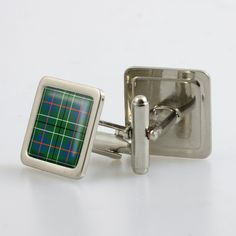 Steel cufflinks set with resin domed tartan - only from ScotClans. The cufflinks are set with a resin domed cabochon in the chosen tartan. Set comes in a metallic finish box.