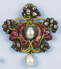 Orchid brooch. Rene Lalique (1860-1945)Yellow gold, plique a jour, pearls.