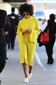 Solange Knowles rocks a neon knit-on-knit outfit with white leather mules