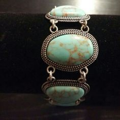 Boho Turquoise Reversible Bracelet This versatile bracelet matches nicely with the Reversible necklace that is also listed. Turquoise on one side and silver plated on the other side. **New with box and has never been worn!!** Premier Jewerly Jewelry Bracelets