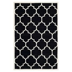Wool rug with a Moroccan trellis motif. Hand-tufted in India.  Product: RugConstruction Material: 100% Wool...
