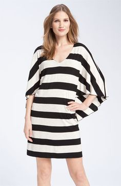 Asymmetrical batwing sleeves lend a cape-like effect to a playful striped jersey dress. $54.97