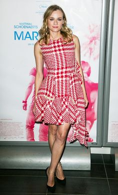Diane Kruger wears a plaid Simone Rocha tweed dress with black heels