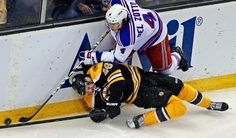 OUCH! Boston Bruins center David Krejci (46) is dropped to the ice on a hard check while battling New York Rangers defenseman Michael Del Zotto (4) for the puck during the second period in Game 5 of the Eastern Conference semifinals in the NHL hockey Stanley Cup playoffs in Boston, Saturday, May 25, 2013. (AP Photo/Charles Krupa) MORE NHL PLAYOFFS PHOTOS HERE
